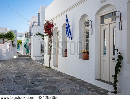 Whitewashed Buildings Cobblestone Alley  Background At Sifnos Island, Greece.