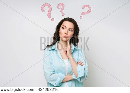 A Confused Woman Stands Uncertainly, Shrugs Her Shoulders, Cant Give An Answer To A Difficult Questi