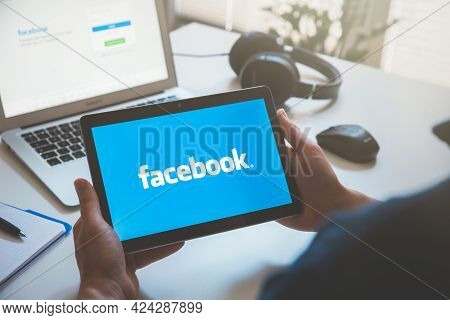Wroclaw, Poland - Jun 17, 2021: Man Using Facebook Appication On Huawei Mediapad T3 Tablet. Facebook