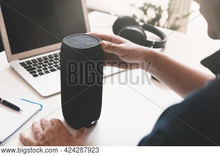 Man Using Smart Speaker. Modern Smart Home Device, Intelligent Assistant Appliance