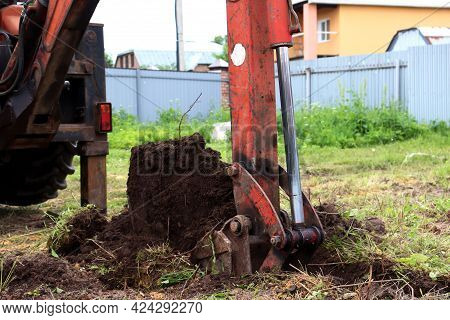 Dirty Bucket Of An Old Excavator. Excavator Digs The Ground
