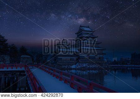 Old Castle In Japan. Castle Against Night Sky. Castle In Winter With Milky Way On Sky .travel Castle