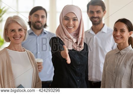 Smiling Asian Muslim Businesswoman With Extended Hand For Handshake