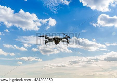 Drone Copter Flying With Digital Camera. Drone With High Resolution Digital Camera. Flying Camera Ta