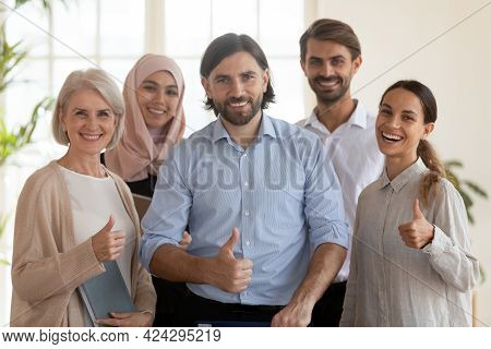 Group Portrait Of Smiling Multiethnic Employees Colleagues Showing Thumbs Up
