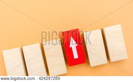 One Red Block With Up Arrow Stands Out From The Rest. Leadership And Victory Concept. Dissimilarity