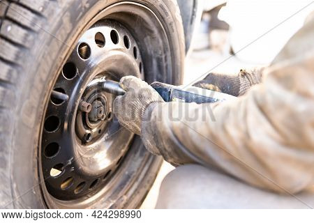 Moscow. Russia. Spring 2019. Replacing The Wheel On The Car. The Tire Will Change The Wheels On Summ