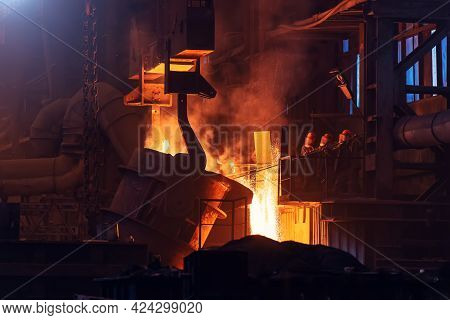 Liquid Iron, Molten Metal Pouring From Ladle, Metallurgical Factory, Foundry Cast.