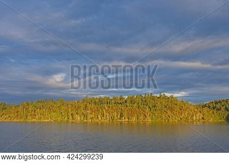 Morning Sun Breaking Through The Clouds On Knife Lake In The Boundary Waters In Minnesota