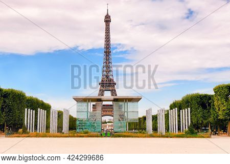 Paris, France - November 13, 2020: Eiffel Tower On Background Of Blue Cloudy Sky In Paris In Summer.
