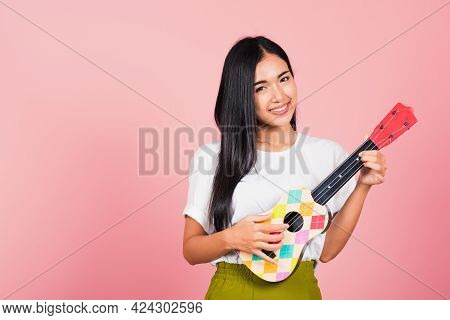 Portrait Of Happy Asian Beautiful Young Woman Teen Confident Smiling Face Hold Acoustic Ukulele Guit
