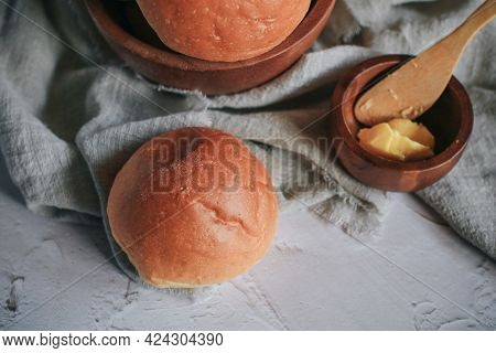 Homemade Bread And Butter For Breakfast On Gray Background. Morning Breakfast With Tea, Butter And T