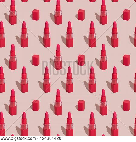 Seamless Pattern Of Red Lipstick And Caps On Pink Background. Red Lipstick In Rows.