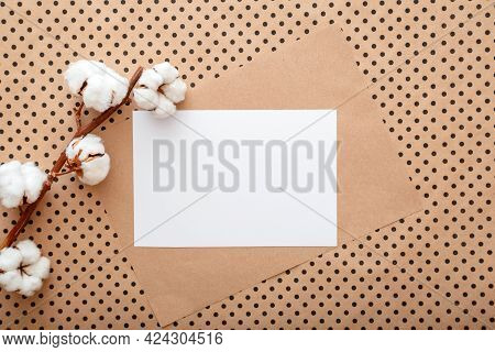 White Blank Paper Card Note Invitation Mockup With Bloom Cotton Flowers Branch. Mockup Blank For Wed