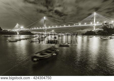 Idyllic Landscape Of Bridge And Bay In Hong Kong City At Night