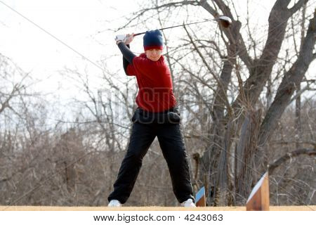 Youth Golfer Hitting A Tee Shot