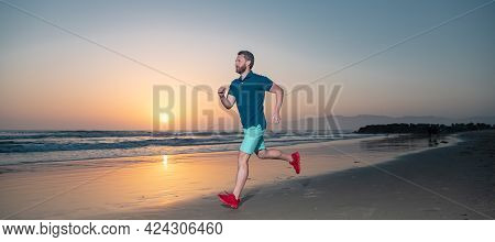 Sporty Man Runner Running In Summer Sea. Healthy Lifestyle Concept. Fit Male Fitness Runner During O