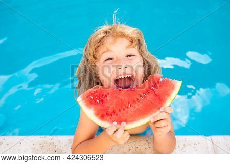 Child Eating Watermelon Near Swimming Pool During Summer Holidays. Kids Eat Fruit Outdoors. Healthy