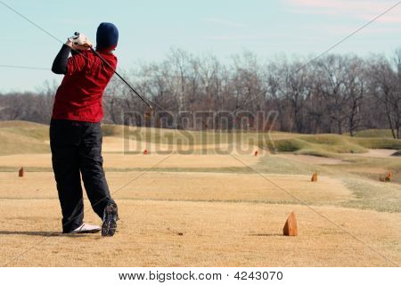 Youth Goler Hitting Iron Tee Shoot