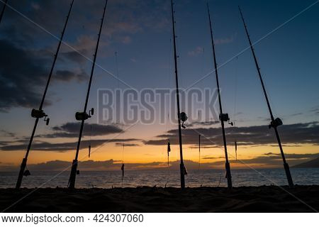 Fishing Rods And Fishing Gear On The Ocean Coast Close Up.