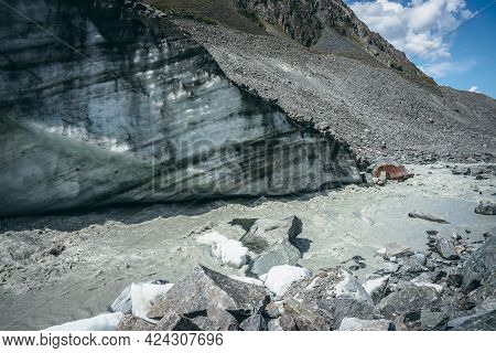 Scenic Landscape With Powerful Mountain River Beginning From Glacier With Ice Chunks. Beautiful Scen