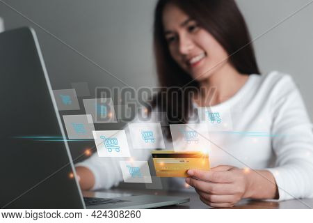 Asian Woman Holding Credit Card And Using Laptop Computer With Icon Shopping Cart, Online Shopping,