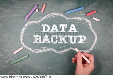 Data Backup. Cloud And Colored Pieces Of Chalk On A Green Chalkboard