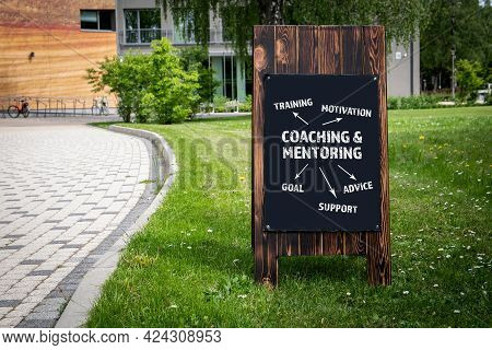 Coaching And Mentoring Concept. Wooden Billboard On The Street, Sunny Day