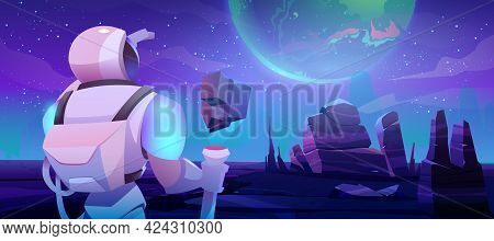 Astronaut Looking On Earth From Alien Planet In Far Galaxy. Cosmonaut In Suit And Helmet Holding Sta