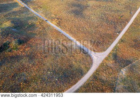 landscape of Nebraska Sandhills, early morning aerial view at Nebraska National Forest with dirt sandy roads