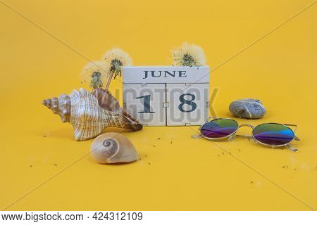 Calendar For June 18: Cubes With The Number 18, The Name Of The Month Of June In English, Shells, Se
