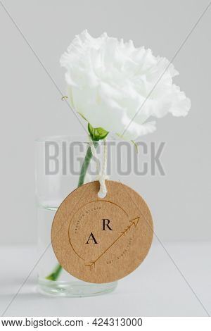 White peony in a cleared vase with a tag mockup