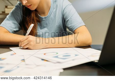 Economics Student. Late Studying. Remote Education. Girl Sitting At Desk Late At Night Reading Books