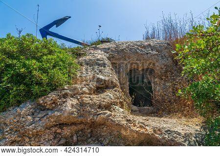 View Of Ancient Byzantine Era Burial Caves, And An Old Anchor, In Ein Hayam Neighborhood, Haifa, Isr