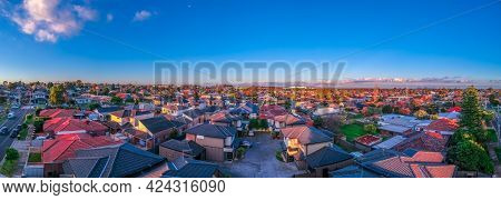 Panoramic aerial Drone view of Melbournes suburbs and CBD looking down at Houses roads and Parks Vic