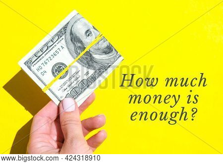 How Much Money Is Enough Quote Female Hand Holding Dollars Close Up. Money Currency. Online Shopping