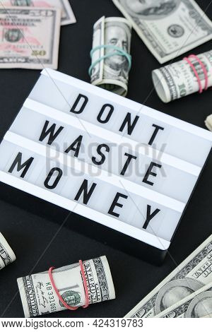 Lightbox Board With Word Dont Waste Money In Black Letters Around Us Dollar Banknotes. Money, Busine