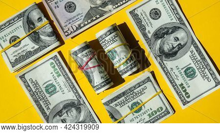 Us Dollar Bills Are Creative Layout. Business Concept, Development Perspective. Flat Lay. Top View.