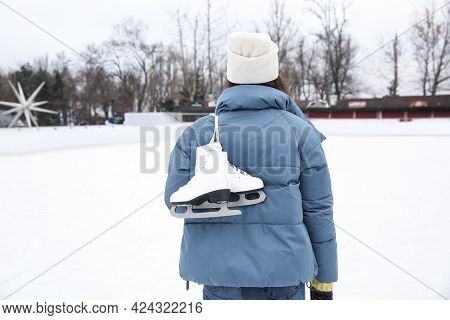 Woman With Figure Skates Near Ice Rink Outdoors, Back View
