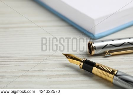 Beautiful Fountain Pen With Ornate Nib On White Wooden Table, Closeup. Space For Text