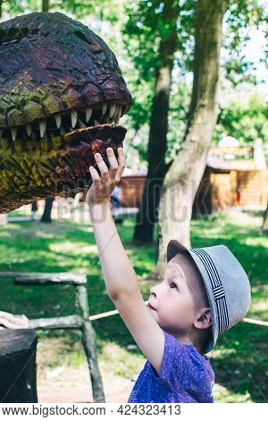 A Close-up Of A Full-length Mini Tyrannosaurus Rex. Reconstruction Of Extinct Species. Swing For Chi