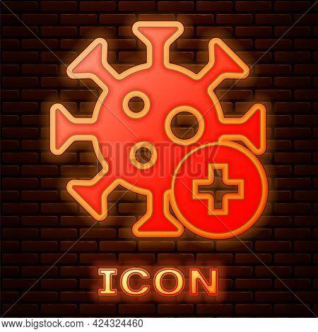 Glowing Neon Positive Virus Icon Isolated On Brick Wall Background. Corona Virus 2019-ncov. Bacteria