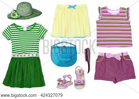 Collage Set Of Little Girl Summer Clothes Isolated On A White Background. The Collection Of A Green