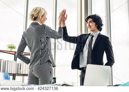 Successful Of Two Business People Giving Hi Five Together