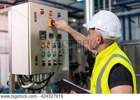 Machine Engineers Inspect Machines And Sterilizers In Food Factories Or Factory Drinking Water Plant