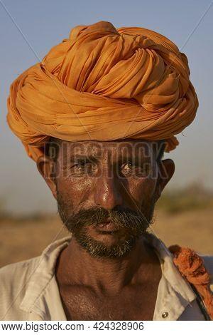 Pushkar, Rajasthan, India - November 6, 2008: Portrait Of A Camel Herder At The Annual Pushkar Fair