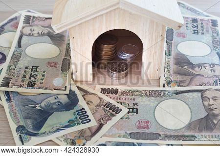 Japanese Yen Notes And Japanese Yen Coins For Money Concept Background.  Used As A Medium Of Exchang