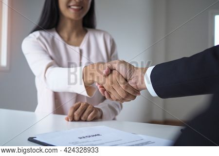 Business Women And Job Seekers Shake Hands After Agreeing To Accept A Job And Approve It As An Emplo