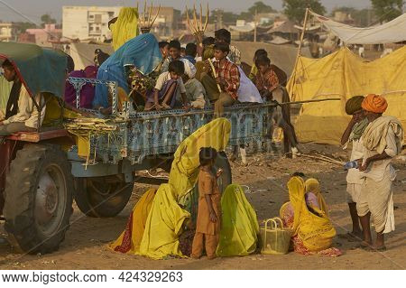 Pushkar, Rajasthan, India - November 9, 2008: Tractor And Trailer Provide Transport At The Annual Pu