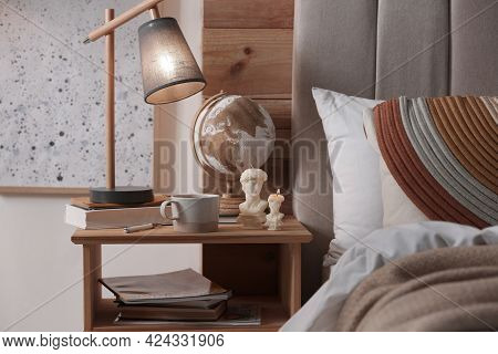 Beautiful David Bust Candles And Cup Of Hot Drink On Table In Bedroom